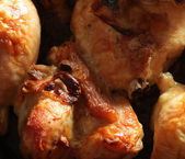 Roast chicken drumsticks on a baking pan — Stock Photo
