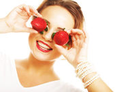 Woman with strawberry on the white background — Stock Photo