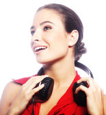 Woman dancing to music with headphones — Stock Photo