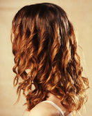 Female curly red hairs - back view — Stock Photo