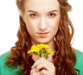 Woman with dandelion bouquet — Stock Photo