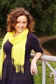 Woman on bridge in autumn park — Stock Photo