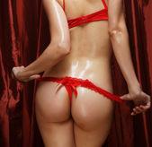 Sexy butt girls in red underwear — Stock Photo