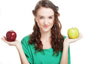 Woman with two different apples — Stock Photo