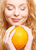 Woman with big orange — Stock Photo