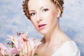 Lady with lily — Stock Photo