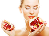 Woman showing pomegranate smiling. — Stock Photo