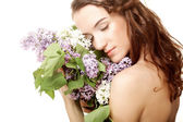 Spring girl with lilac flowers. — Stock Photo