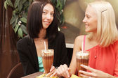 Young women having coffee break together — Stock Photo
