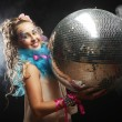 Woman in doll style with disco ball — Stock Photo