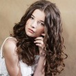 ストック写真: Beautiful young womwith curly hair.