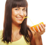 Beautiful woman drinking juice with straw — Stock Photo