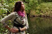 Fashion happy woman near the river — Stock Photo