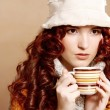 Young pretty woman drinking coffee — Stock Photo