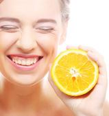 Cheerful woman with oranges in her hands — Stock Photo