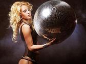 Girl in smoke with disco ball — Stock Photo