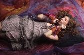 Beautiful woman lay on organza. Sleeping beauty. — Stock Photo