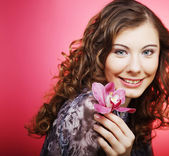 Woman with orchid flower over pink background — Stock Photo