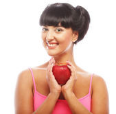 Young brunette woman with red apple — Stock Photo