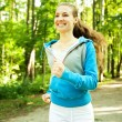 Pretty young girl runner in the forest. — Stock Photo #41931837