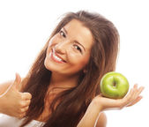 žena se zelenými jablky a zobrazeno palec nahoru — Stock fotografie