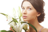 Woman with a lily flowers — Stock Photo