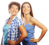 Mother and adult daughter looking up — Stock Photo