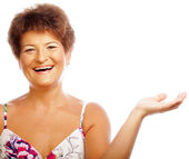 Mature woman stretching her hand on wh — Stock Photo