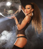 Dancer girl in smoke with disco ball — Stock Photo