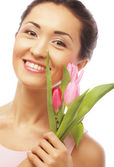 Young asian woman with tulips — Stock Photo