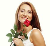 Beautiful woman with red rose — Stock Photo