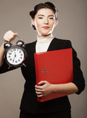 The business woman with an alarm clock — Stock Photo