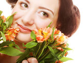 Woman fith bright pink-yellow flowers — Stock Photo