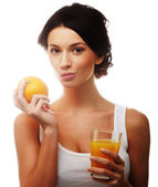Woman holding  orange juice — Stock Photo