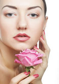 Woman with pink rose — Stock Photo