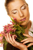 Woman with pink flowers — Foto de Stock
