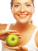 Beautiful woman with green apple — Stok fotoğraf