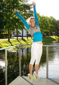 Sporty woman jump outdoor — Stock Photo