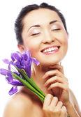 Young asian model with iris flowers. — Zdjęcie stockowe