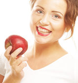 Young girl with a red apple in hand — Stock Photo