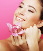 Happy woman with orchid flower — Stock Photo