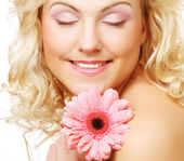 Beautiful young woman with gerber flower — Stock Photo