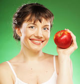 Healthy woman with fresh red apple — Stock Photo