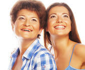 Mother and adult daughter looking up — Foto Stock