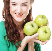 Woman with three apples — Stock Photo