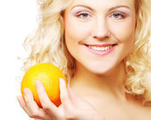 Portrait of a healthy happy woman with an orange — Стоковое фото