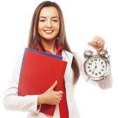 The business woman with an alarm clock — Zdjęcie stockowe