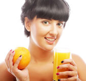 Brunette woman holding orange juice — Stock Photo