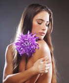 Beaytiful woman with big flower — Stock Photo