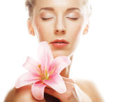 Beauty face of  woman with pink lily — Stock Photo